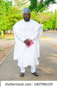 Handsome African man dressed in White Traditional Nigerian attire