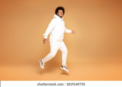 Handsome African man wearing fashionable tracksuit.