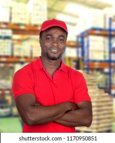 Handsome african man working at logistics warehouse
