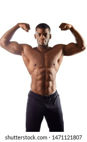 handsome afro man shows body and abdominal muscles over white background. close up portrait. wellbeing, wellness