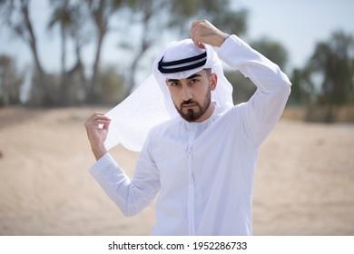 Handsome Arabic man. Local Arab national on Kandura looking on far during bright daytime.