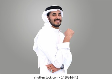 Handsome Arabic Muslim man standing wearing traditional Middle Eastern menswear in the gulf called Kandura