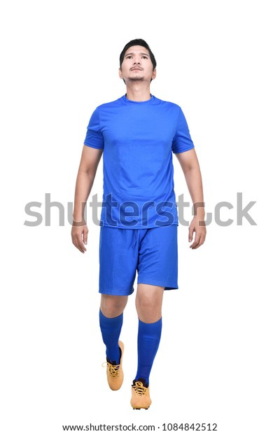 Handsome asian athlete man with blue jersey standing isolated over white background
