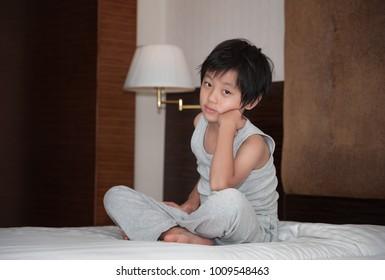 Handsome Asian boy posing indoor