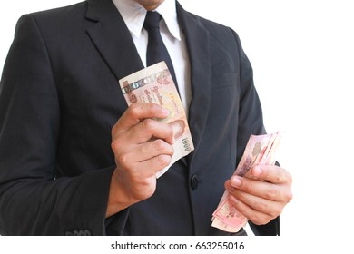 Handsome Asian business man counting money, isolate on white background