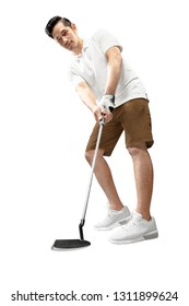 Handsome asian man golf player swing the putter club to put the ball into the hole standing isolated over white background