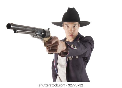 Handsome Asian man with handgun pointed at the camera ready to shoot