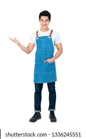 Handsome Asian man wearing apron with open hand standing in white background