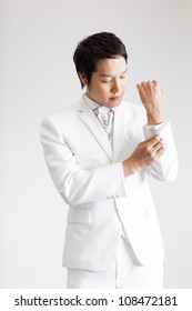 Handsome Asian man are wearing a white suit.Take photo in Studio.