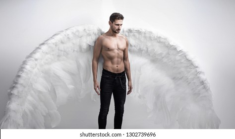 Handsome athlete man as an angel