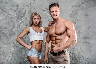 Handsome athletic fitness woman holding a shaker and posing