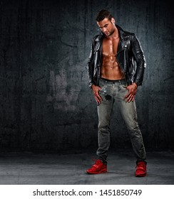 Handsome Athletic Male Fashion Model in Leather Jacket and Jeans