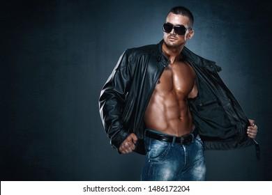 Handsome Athletic Male Model Wearing Leather Jacket on Naked Torso