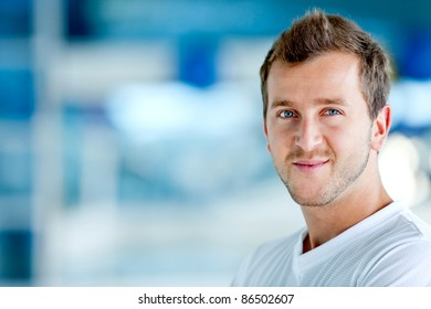 Handsome athletic man at the gym smiling