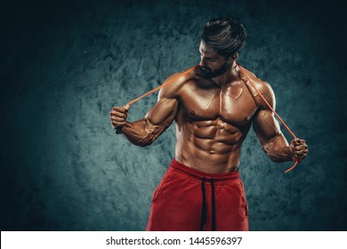 Handsome Athletic Man Posing With Jump , Skipping Rope