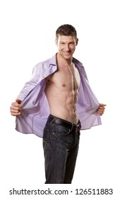 handsome athletic man with a smile and an open shirt on white background