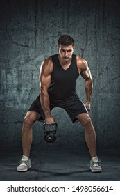 Handsome Athletic Men Exercising With Kettlebell