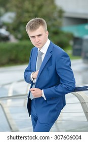 Handsome and attractive businessman in suit, Business Centre Moscow City, Bagration Bridge