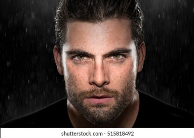Handsome attractive dark intense eyes passionate intensity powerful stare strong sexy man in rain