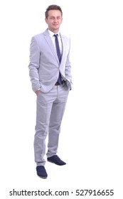 Handsome attractive male model in elegant gray suit holding hands in pocket isolated on white background, full length