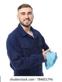 Handsome auto mechanic wiping hands on white background