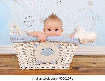 handsome baby boy playfully peeking out of wicker basket