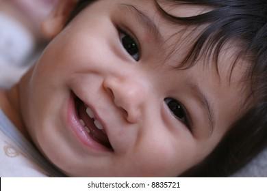 Handsome baby boy smiling into camera