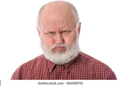 Handsome bald and bearded senior man shows resentful facial expression, isolated on white background