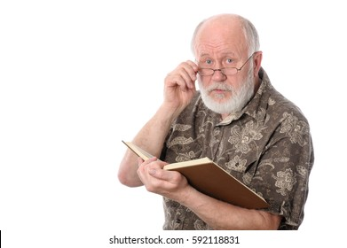 Handsome bald and bearded senior man looking over glasses when reading a book, isolated on white background