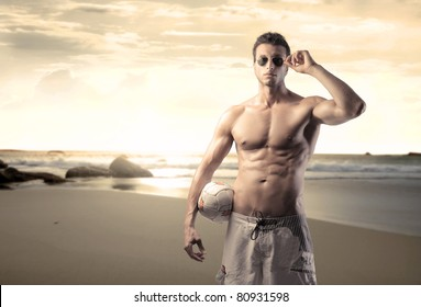 Handsome bare-chested man at the seaside