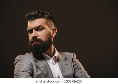 handsome beard businessman in gray jacket isolated on brown