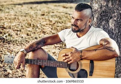 Handsome beard man with guitar