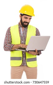 Handsome beard young engineer smiling and holding a laptop, guy wearing caro shirt and beige pants with a yellow vest and yellow helmet, isolated on white background