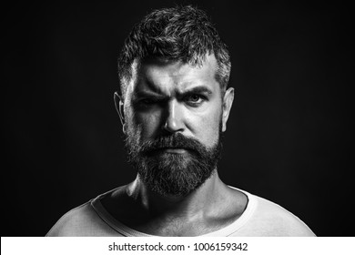 Handsome bearded boxer, well built, muscular kickboxer or muay thai fighter. Brutal bearded boxer, ready to fight. Boxing, workout, muscle, strength, power - sport concept. Black and white.
