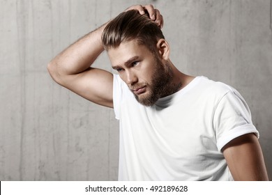 Handsome bearded man in a blank white t-shirt with stylish hair