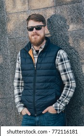 Handsome Bearded Man In Casual Clothes Posing On Camera City Background