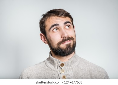 handsome bearded man cheerfully ignores, closeup on background