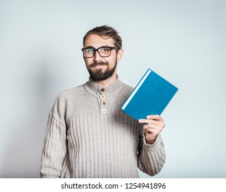 handsome bearded man with notepad, closeup over background