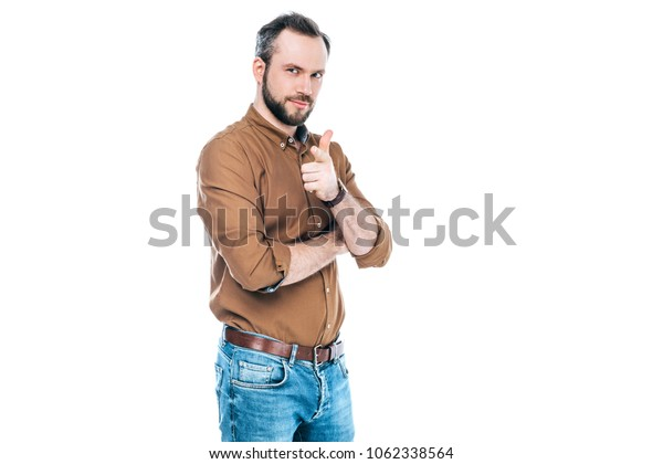 handsome bearded man pointing at camera with finger isolated on white