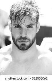 Handsome bearded man young guy male with beard and wet hair outdoors on sunny day black and white