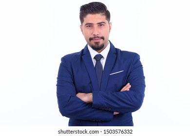 Handsome bearded Persian businessman with arms crossed