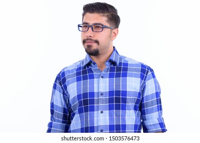 Handsome bearded Persian hipster man with eyeglasses thinking