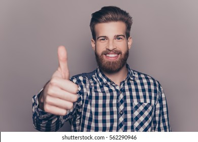 Handsome bearded smiling man showing thumb up