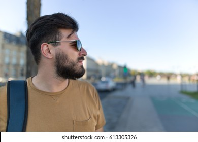 Handsome black bearded man as a tourist exploring the city. Portrait of a european handsome man.