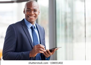handsome black businessman using tablet pc