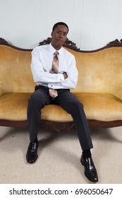 Handsome Black Businessman in a white shirt and a tie,  looking happy