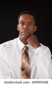Handsome Black Businessman in white shirt and tie looking thoughtful
