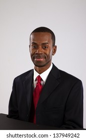 Handsome black man in a business suit, looking at the camera with a pleased smile