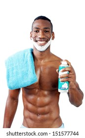 A handsome black man, holding a can of shaving cream, with shaving cream applied to his face.