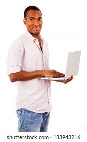 Handsome black man with laptop on white background